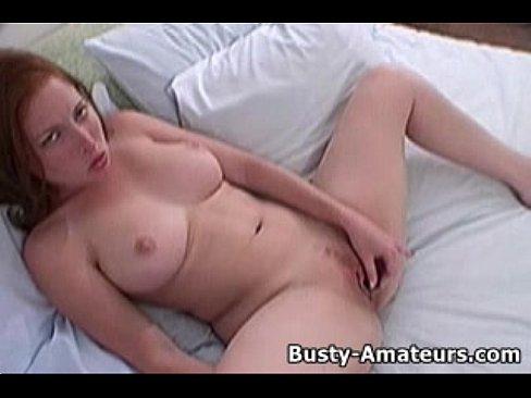 Busty red head masturbating seems