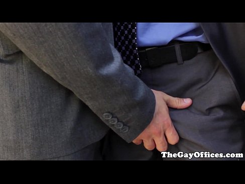Uniformed office hunk squirted with cum