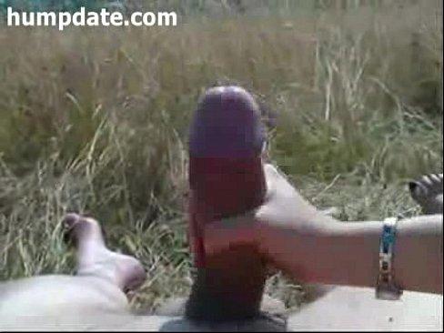 Guy with big fat cock gets outdoor handjob