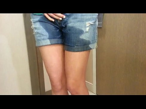 girl wets her jean shorts