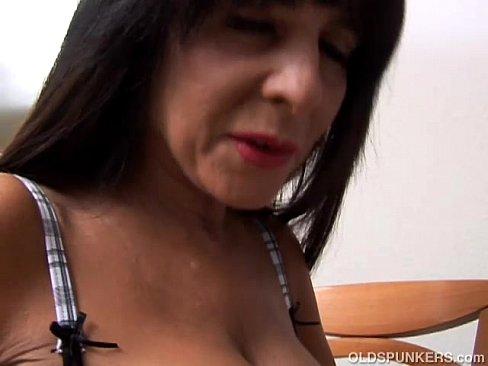 Beautiful brunette stripping