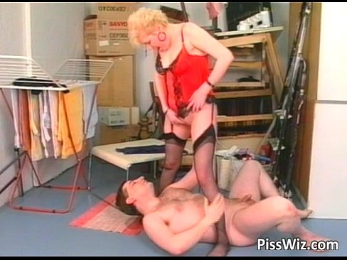 Mature blonde whore sucking cock