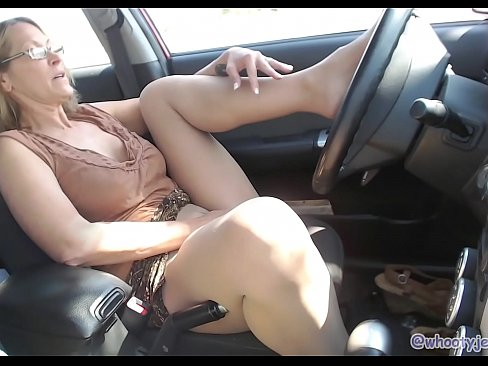 girl playing naked in a car