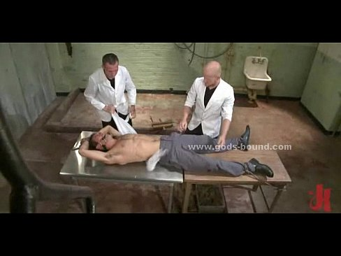 Patient locked in cage tied in gay bdsm fetish sex with screaming