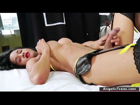 Busty tranny Emma C jerks her huge shecock and cums on her outfit